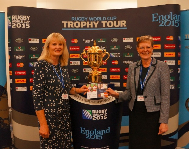 Sharon and Sue with the Webb Ellis trophy - and the Read South West rugby booklet