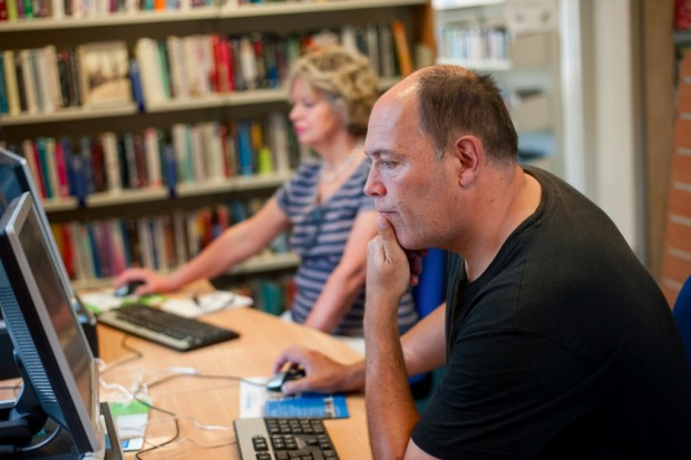 Visitors using library PCs in Canford Cliffs, Poole.