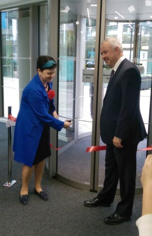 Baroness Neville Rolfe cuts the ribbon, watched by Councillor Ben Adams