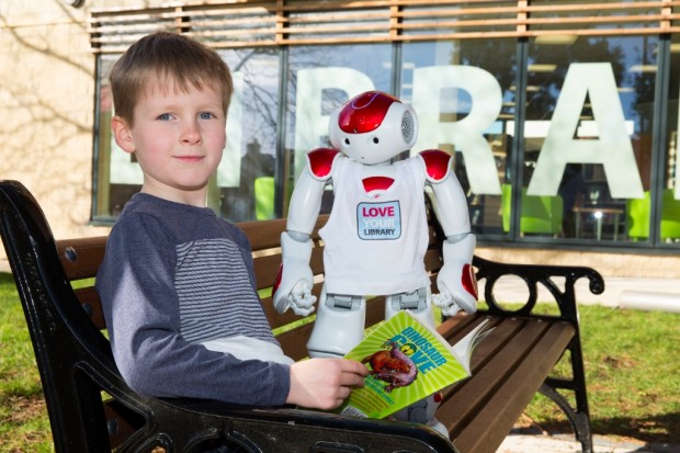 Child with NEO - the robot who welcomed visitors to the new library.