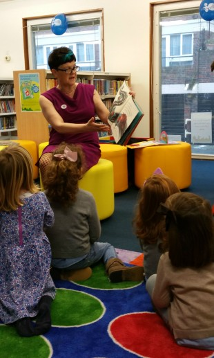 Baroness Neville Rolfe reading to children in Northcote library.