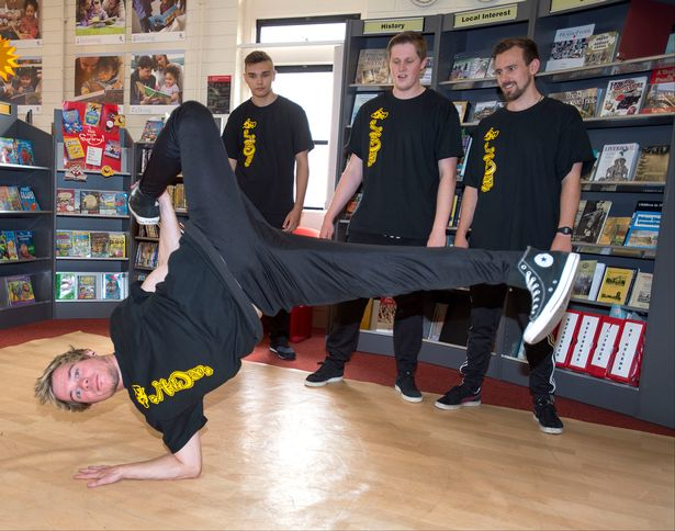 """UC Crew - an award winning youth organisation in St Helens taking part in """"Books and Breakin"""": 13 Library Flashmob Challenge. Photo credit: St Helens Council"""