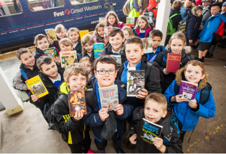 Children from St Martin's school, Liskeard, bring a book as their 'ticket' to travel. Photo credit: GWR