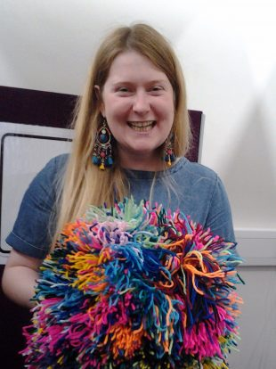 Playing with PomPoms. Photo credit: Surrey Libraries