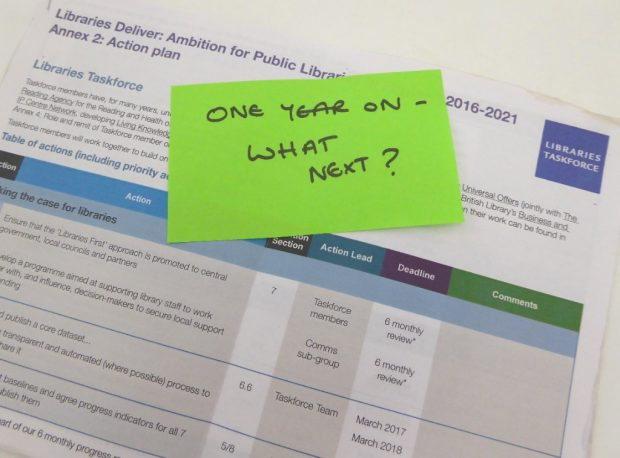printed action plan with postit note saying: one year on - what next?