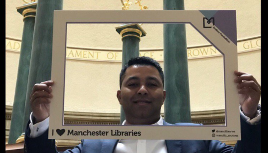 Cllr Rahman in the reading room in Central Library.