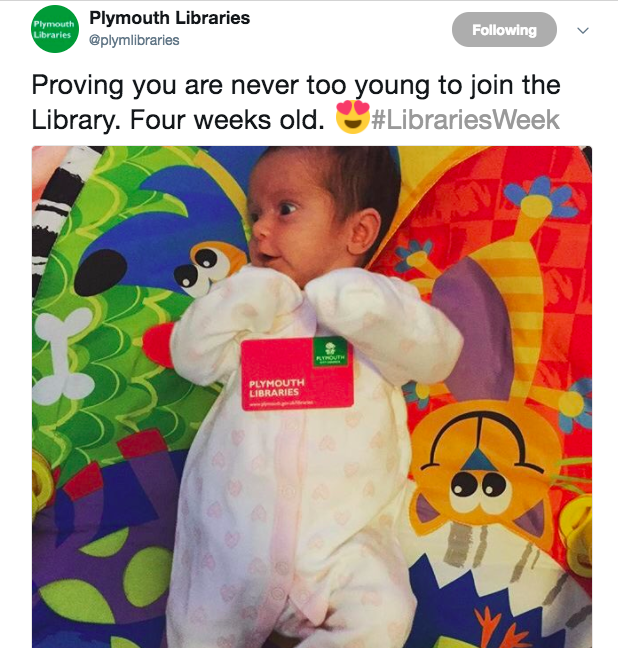 screenshot of tweet showing baby with library card