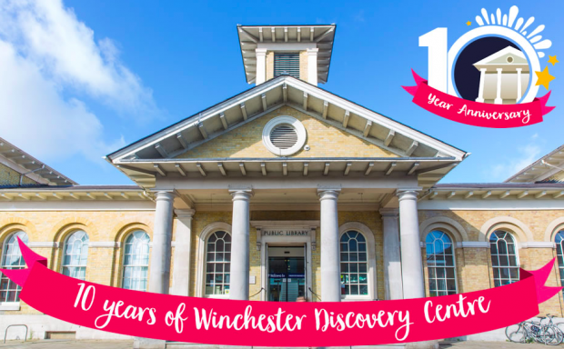 Photo of the front of a library with a banner across it saying 10 years of Winchester Discovery Centre