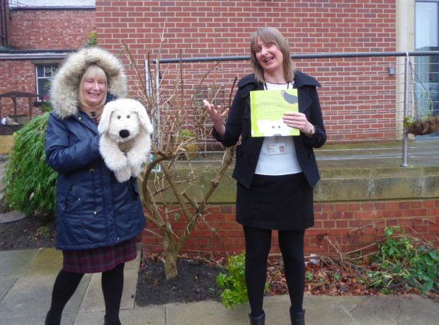 Walking with a puppy in Gateshead library garden. Photo credit: Julia Chandler/Libraries Taskforce