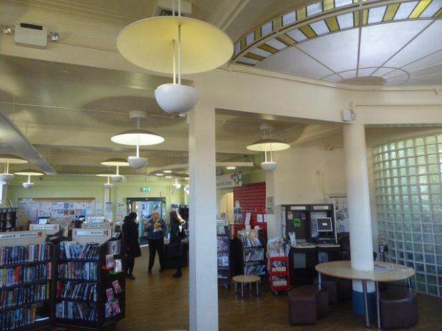 Photo of the inside of a library which has a semi circular skylight in the ceiling.