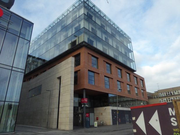 Photo of the outside of the Woolwich centre - a multi-storey glass and brick building