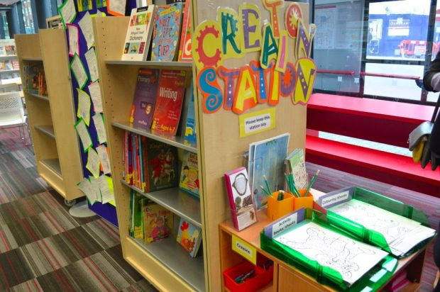 Photo of activity sheets, pencils and crayons in the library