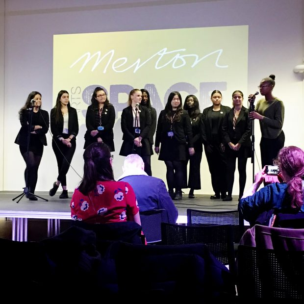 Photo of a group of young women on stage