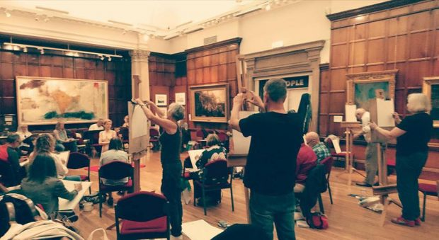 People participating in a life drawing class.