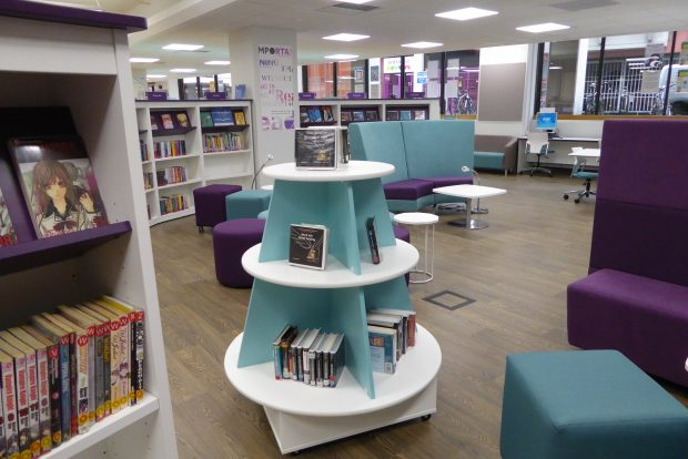Photo of a library with books and comfy seating