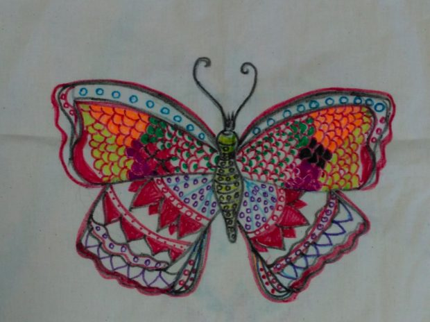 Photo of a piece of embroidery which is of a butterfly.