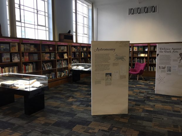 Photo of an exhibits board in a room in the library