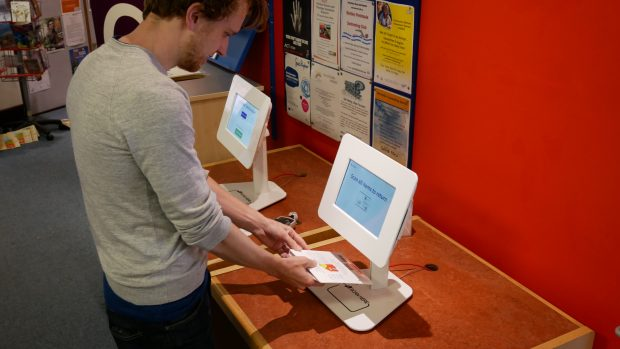 Scanning an item to return it. Photo credit: Suffolk libraries