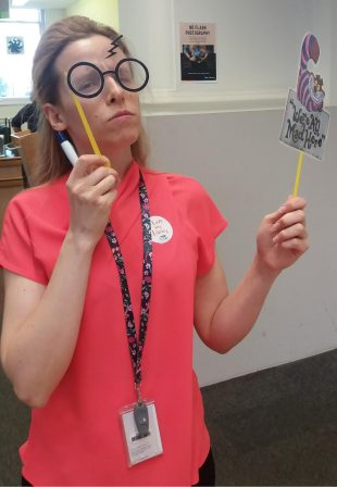 Stephanie demonstrating the selfie props. Photo credit: Gloucestershire libraries