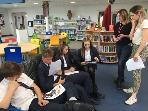 Photo of library staff working with young people in the Sybil Andrews Academy.