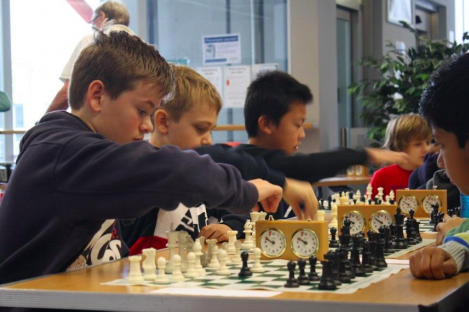 Photo of a boys playing chess