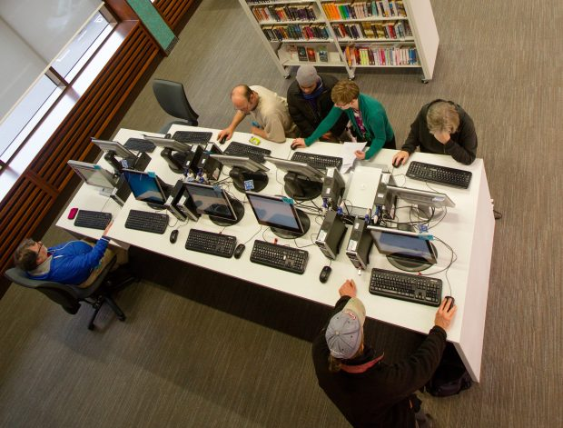 Aerial photo of people using computers in Exeter library