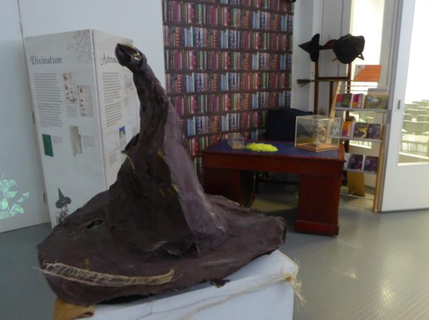Photo of a sorting hat in a corner of the exhibition in Leeds central library