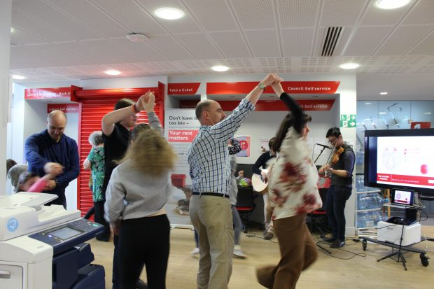 Photo of people dancing in a science ceilidh.