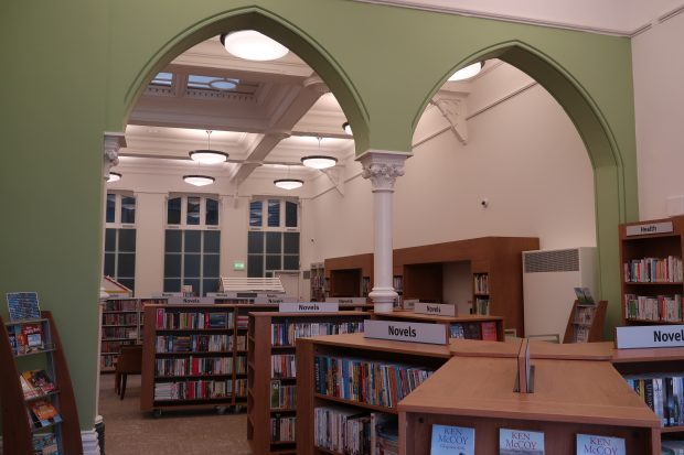 Photo of the inside of a room in the library with gothic arches and a decorated pillar