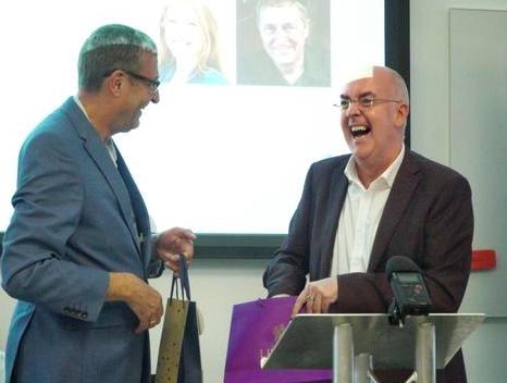 Photo of 2 men smiling - Mark Freeman (left) and Neil Macinnes (right).