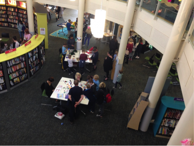 Photo of inside Worksop library looking down from the first floor gallery into the space below.