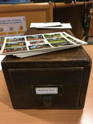 Photo of an index box of postcards.