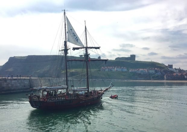 Photo of a wooden sailing ship with 2 masts arriving in Whitby