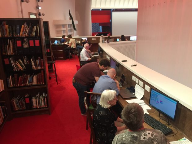 Photo of adults working on laptops in Storyhouse - the new library in Chester