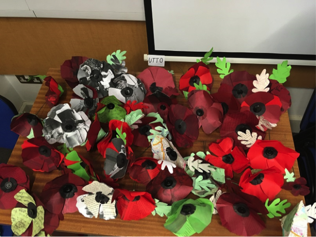 a pile of red handmade poppies