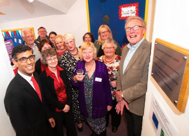 A group of people at the opening of the new extension