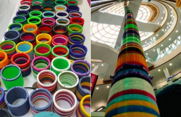 A photo of a table full of coloured discs and another photo where all the discs stacked on top of each other rising to the ceiling of the library
